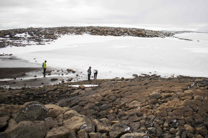 People look at the snow at the old glacier after a monument was unveiled at site of Okjokull, Iceland's first glacier lost to climate change in the west of Iceland on August 18, 2019. (Photo by Jeremie RICHARD / AFP)