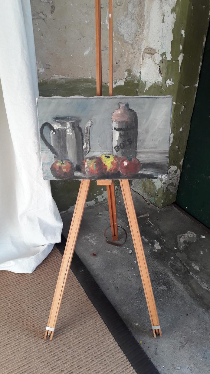 Niet alleen met rommelen in de tuin kan Henk zijn kop leeg maken, ook schilderen werkt ontspannend.