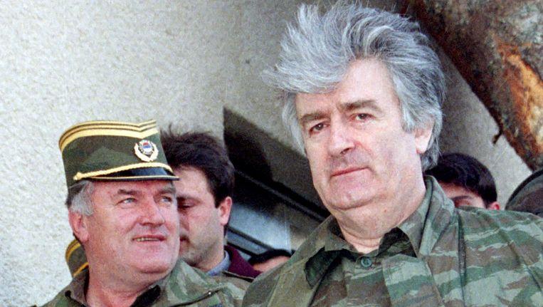 Karadzic (r) en Mladic (l) in april 1995. Beeld Reuters