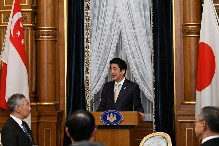 Archiefbeeld van Shinzo Abe tijdens een toespraak. Beeld anp