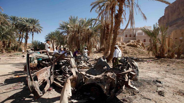 Het wrak van een auto in Jemen na een aanval met een Amerikaanse drone. Beeld REUTERS