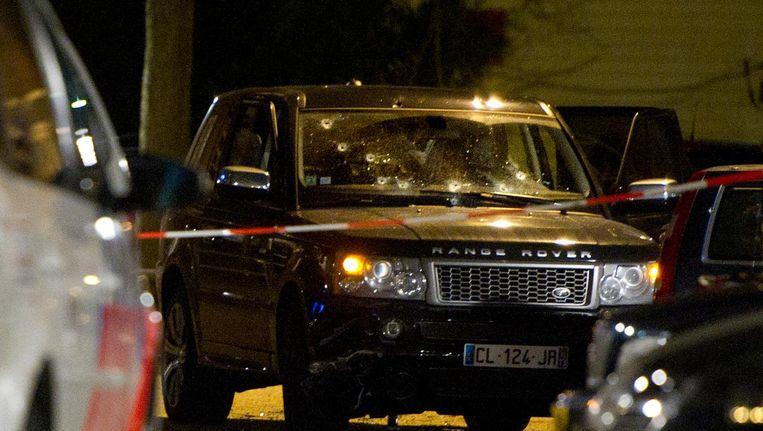 Een zwarte Range Rover, beeld van na de schietpartij in de Staatsliedenbuurt. Beeld anp