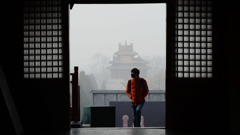 Beijing is sinds vijf dagen gehuld in een dikke laag smog met gevaarlijk veel fijnstof. Beeld AFP
