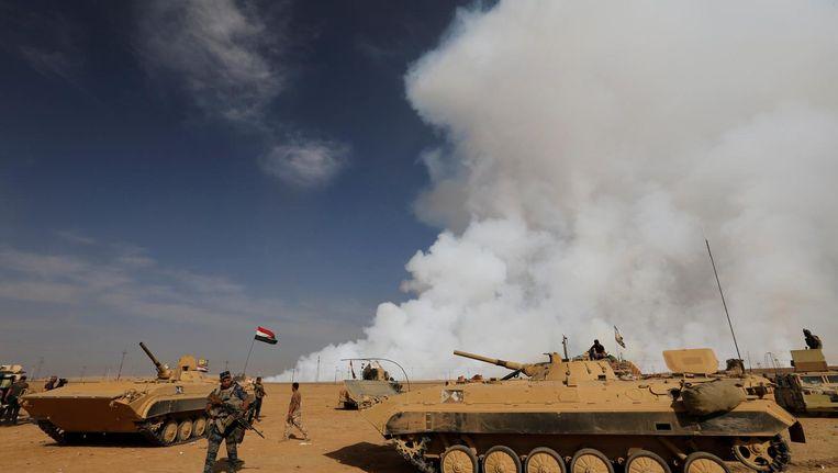 Het Iraakse leger na de bevrijding van een dorp ten zuiden van Mosul. Beeld reuters