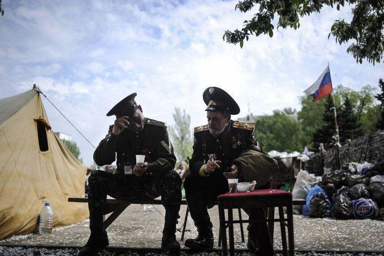 Pro-Russische kozakken gisteren voor een overheidsgebouw in Donetsk.