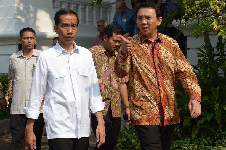 De nieuwe Indonesische president Joko Widodo (links, in witte blouse). Beeld null
