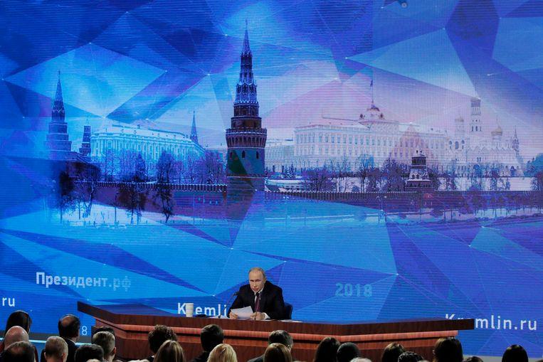 Poetin spreekt tijdens de jaarlijkse persconferentie. Beeld REUTERS