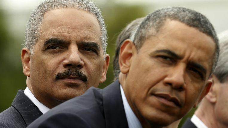 Minister van Justitie Eric Holder en president Barack Obama. Beeld reuters