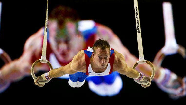 Yuri van Gelder in actie tijdens de wereldbekerwedstrijden turnen van het onderdeel ringen in Gent. © anp Beeld