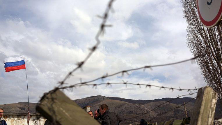 De Russische vlag wappert op de Krim Beeld getty