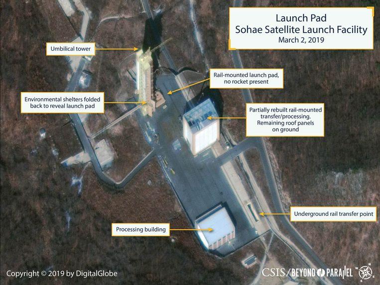 Op deze satellietfoto die in maart 2019 gepubliceerd werd, zou te zien zijn dat bij lanceerinstallatie Tongchang-ri gesloopte gebouwen hersteld worden. Beeld EPA