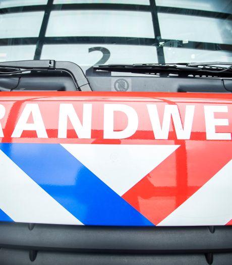 Winkels tijdelijk ontruimd vanwege brand op dakterras in Rhenen