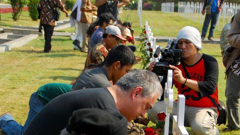 Herdenking van de slachtoffers tijdens de Bersiap-periode op het Nederlandse Ereveld Kembang Kuning in Surabaya, okt. 2013. Beeld Indra Eka Saputra