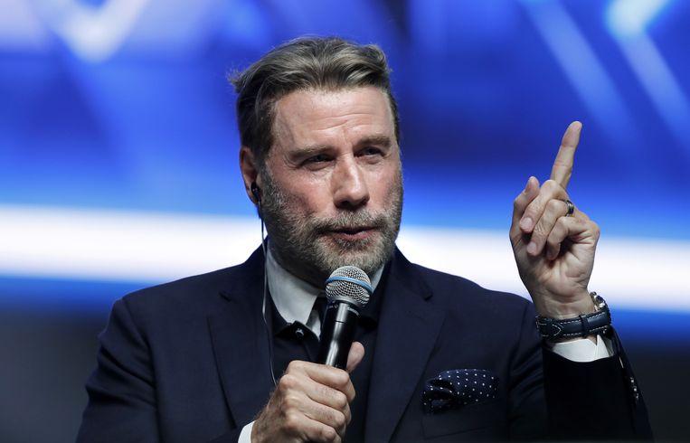John Travolta nog met haar.
