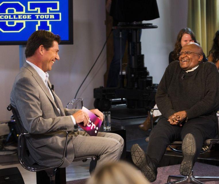 Twan Huys met Desmond Tutu Beeld anp