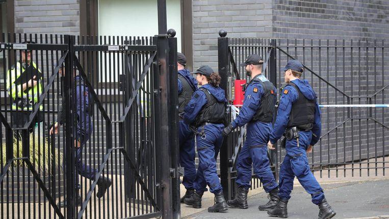De politie sluit Lindy Road in Manchester af. Beeld getty