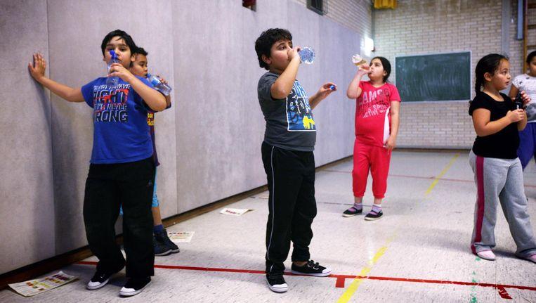 Bij de bestrijding van overgewicht bij kinderen vraagt de situatie van meisjes om extra aandacht Beeld Jean-Pierre Jans