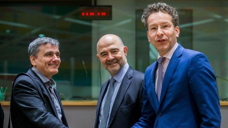 Jeroen Dijsselbloem met de ministers van Financiën van Malta en Frankrijk. Beeld epa
