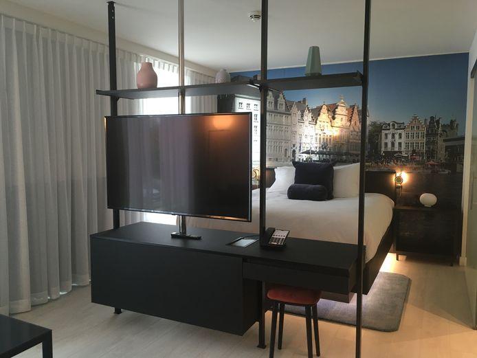 Een kamer, ruim en gezellig, met een zicht op Gent.