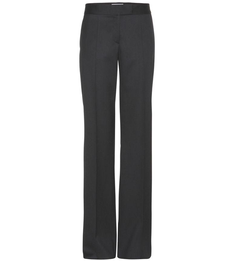 Zwarte wollen broek met mannelijke pasvorm van Stella McCartney, € 360. mytheresa.com. Beeld -