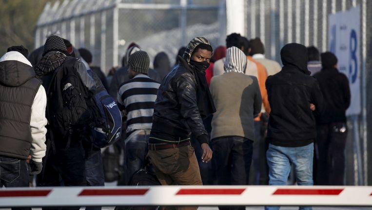 Vluchtelingen en migranten op het Griekse eiland Lesbos. Beeld REUTERS