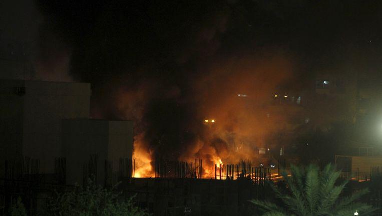 Rook en vlammen na de aanslag Beeld REUTERS