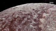 VIDEO: Vlieg mee over bergketens en ijsvlaktes van Pluto