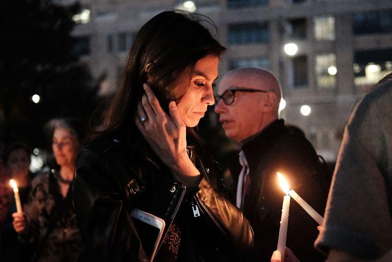 Mensen komen samen voor een wake om de slachtoffers van de aanslag in New York te herdenken.