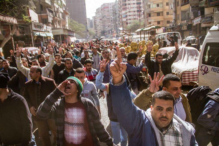 Morsi-aanhangers demonstreren in Caïro. Beeld ap