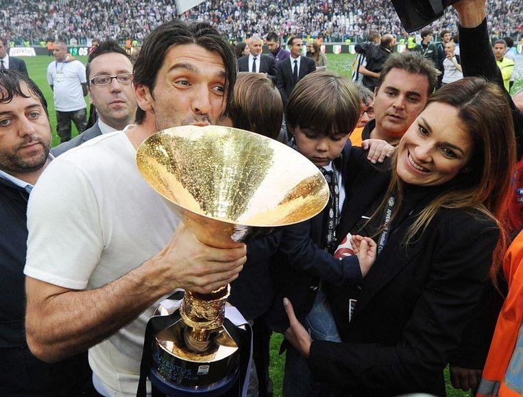 Buffon met vrouw en kinderen.