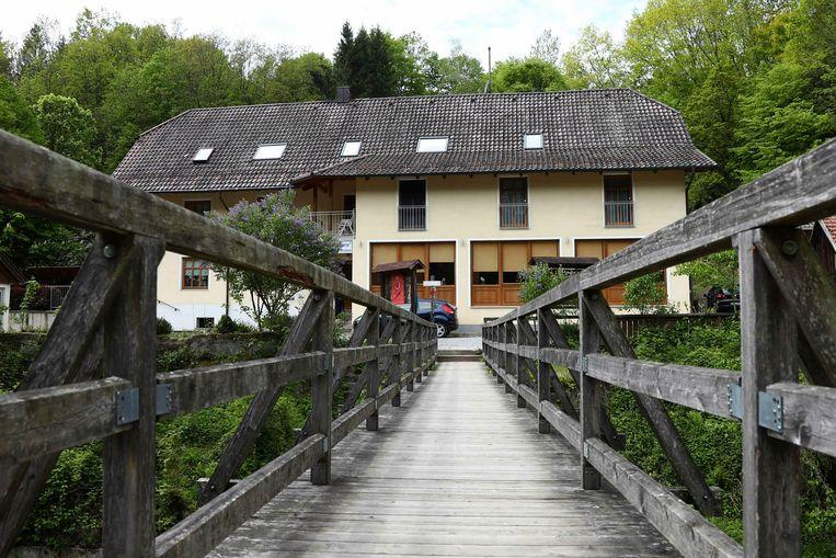 Het pension in Passau waar drie doden werden aangetroffen. Beeld AP