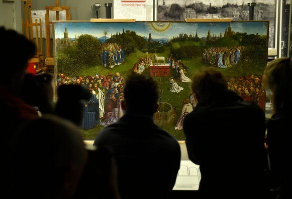 De onthulling van het Lam Gods van Van Eyck.