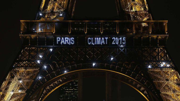 'Parijs klimaat 2015' stond te lezen op de Eiffeltoren toen in 2013 bekend werd gemaakt dat Parijs de klimaatconferentie zou organiseren.