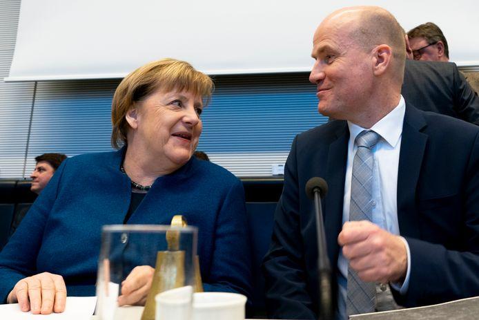 Angela Merkel met Ralph Brinkhaus, fractievoorzitter van de 'Union' in de Bondsdag.