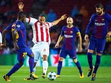 Barcelona met tien man steviger  aan kop na zege op Olympiakos