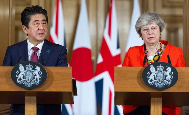 Shinzo Abe en Theresa May.