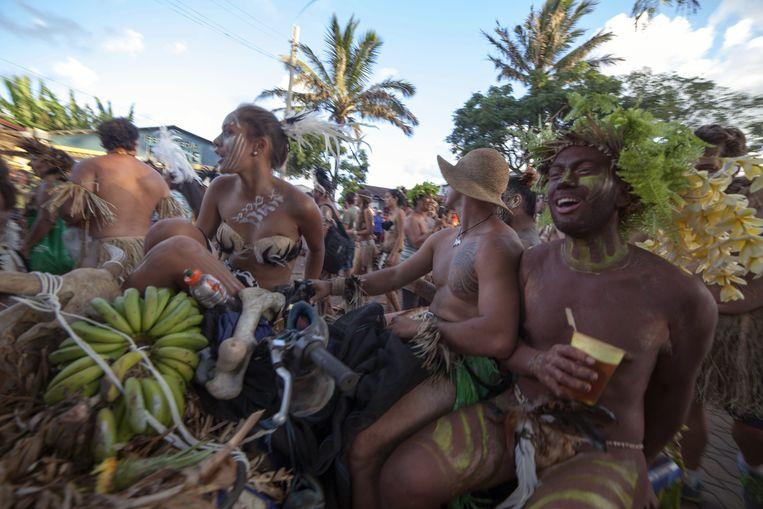 Eilandbewoners vieren Tapati Rapa Nui, een festival waarin twee weken lang de kracht van de man en de gratie van de vrouw wordt gevierd. Beeld AFP
