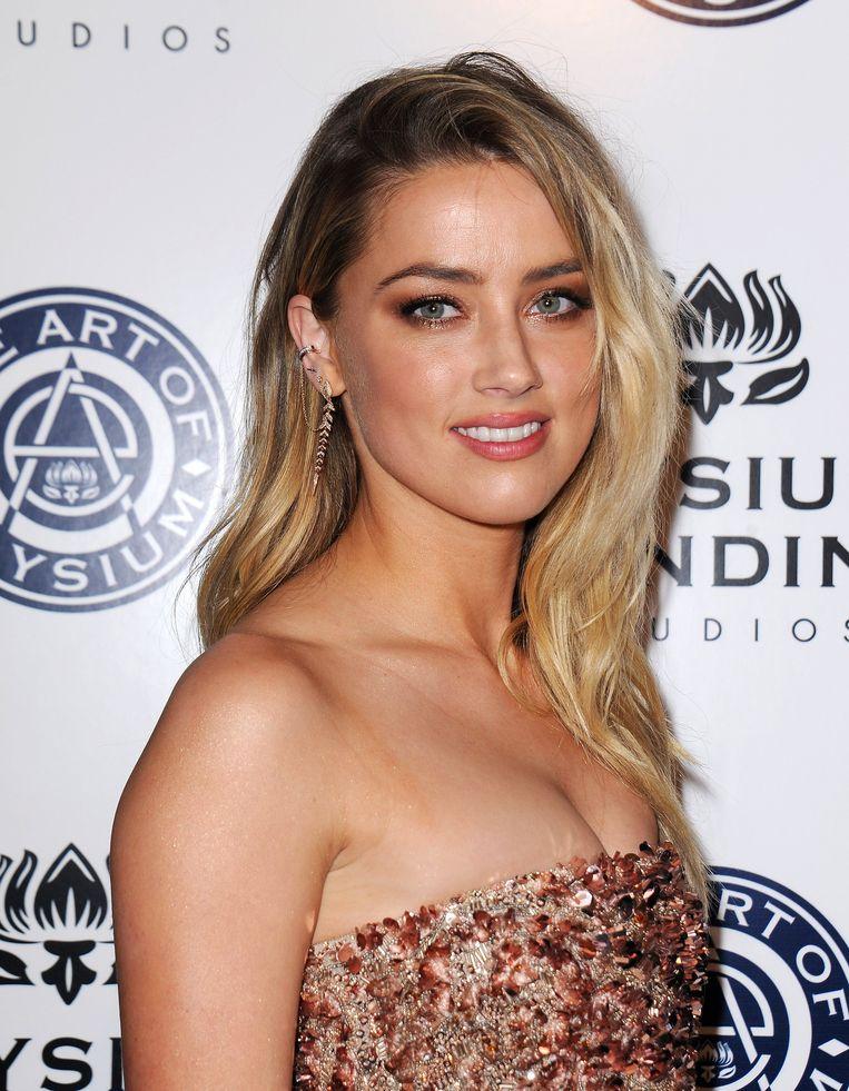Sean Penn werd op date gespot met Amber Heard, de ex van Johnny Depp en Elon Musk.