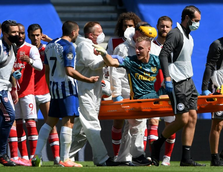 Arsenal goalkeeper Bernd Leno argues with Brighton and Hove Albion's Neal Maupay (left) as he is stretchered off the pitch with an injury during the Premier League match at the Amex Stadium, Brighton. ! only BELGIUM !
