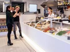 Viswinkelier staakt strijd tegen sluiting door gemeente Amsterdam