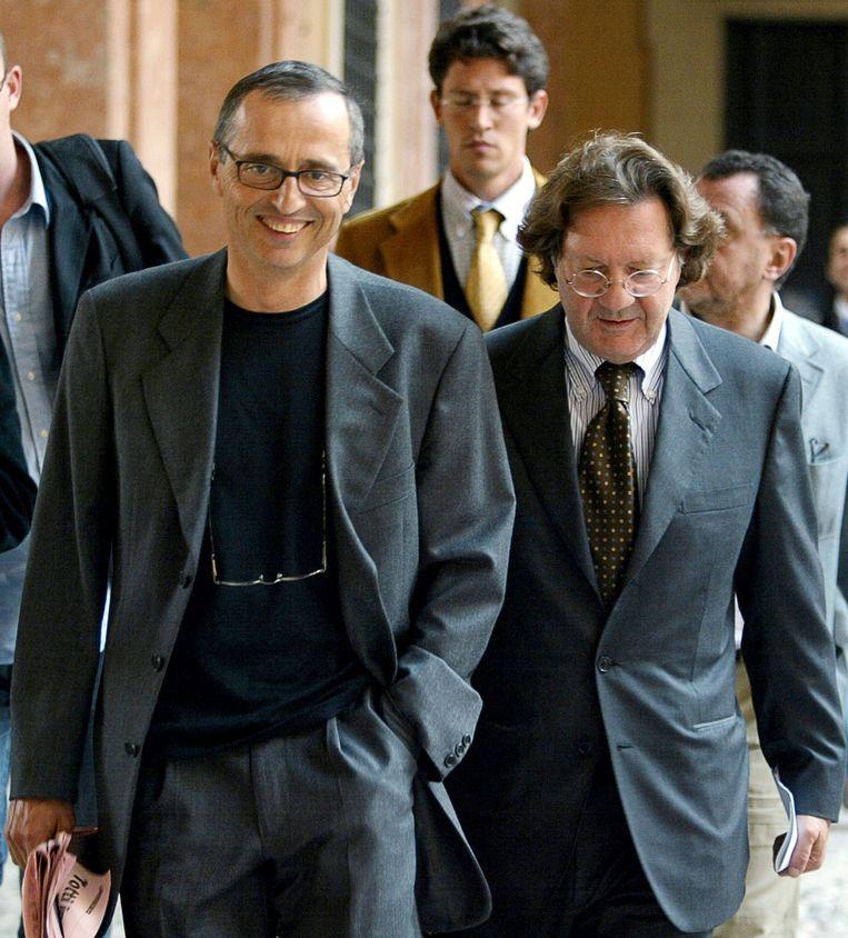 Michele Ferrari (links) in 2004 met zijn advocaat Dario Bolognesi.  Beeld AFP