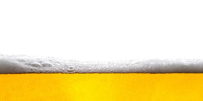 Beer Background Bubbles. Close Up of Beer Foam. bier