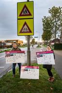 Tim Hesseling en Sanne van Deelen met de verzamelde handtekeningen.
