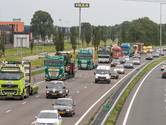 Opvallende stoet met 70 trucks over N50 en A28