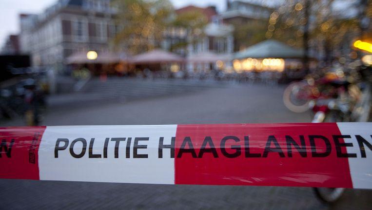 Een afzetlint rond het terras van de Grote Markt in Den Haag Beeld anp