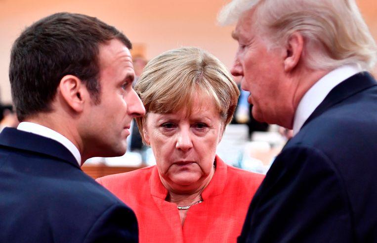 Macron, Merkel, Trump in juli 2017 op de G20-top in Hamburg.  Beeld AFP