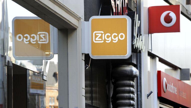 Ziggo en Vodafone naast elkaar in Den Haag. Volgens de Consumentenbond blijft er na een fusie tussen beide bedrijven te weinig concurrentie over op de Nederlandse telecommarkt. Beeld Hollandse Hoogte
