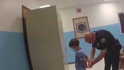 Beelden van agent die kind probeert te boeien, veroorzaken ophef