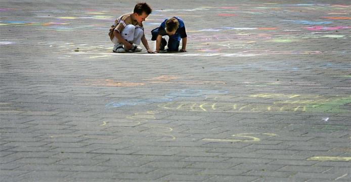 Spelende kinderen, foto ter illustratie.