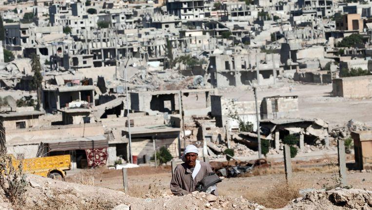 Strijders van Islamitische Staat hebben in de nacht van woensdag op donderdag aanvallen uitgevoerd op de Syrische grensstad Ayn al-Arab, beter bekend onder de Koerdische naam Kobani. Bij de gevechten zouden donderdag al tientallen slachtoffers zijn gevallen. (archieffoto) Beeld epa